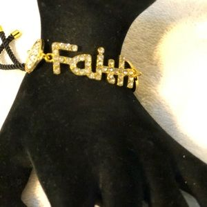 Gold colored bracelet with the word FAITH